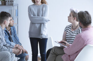 a woman participates in narcotics anonymous